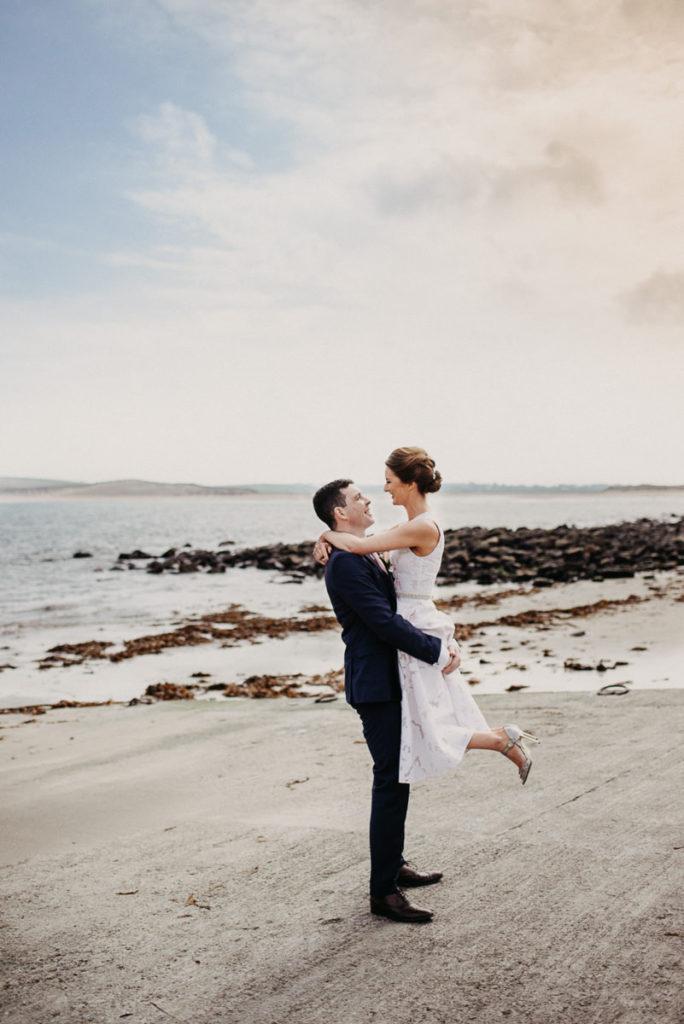 Couple posing in a popular wedding photography spot in Sligo Bay